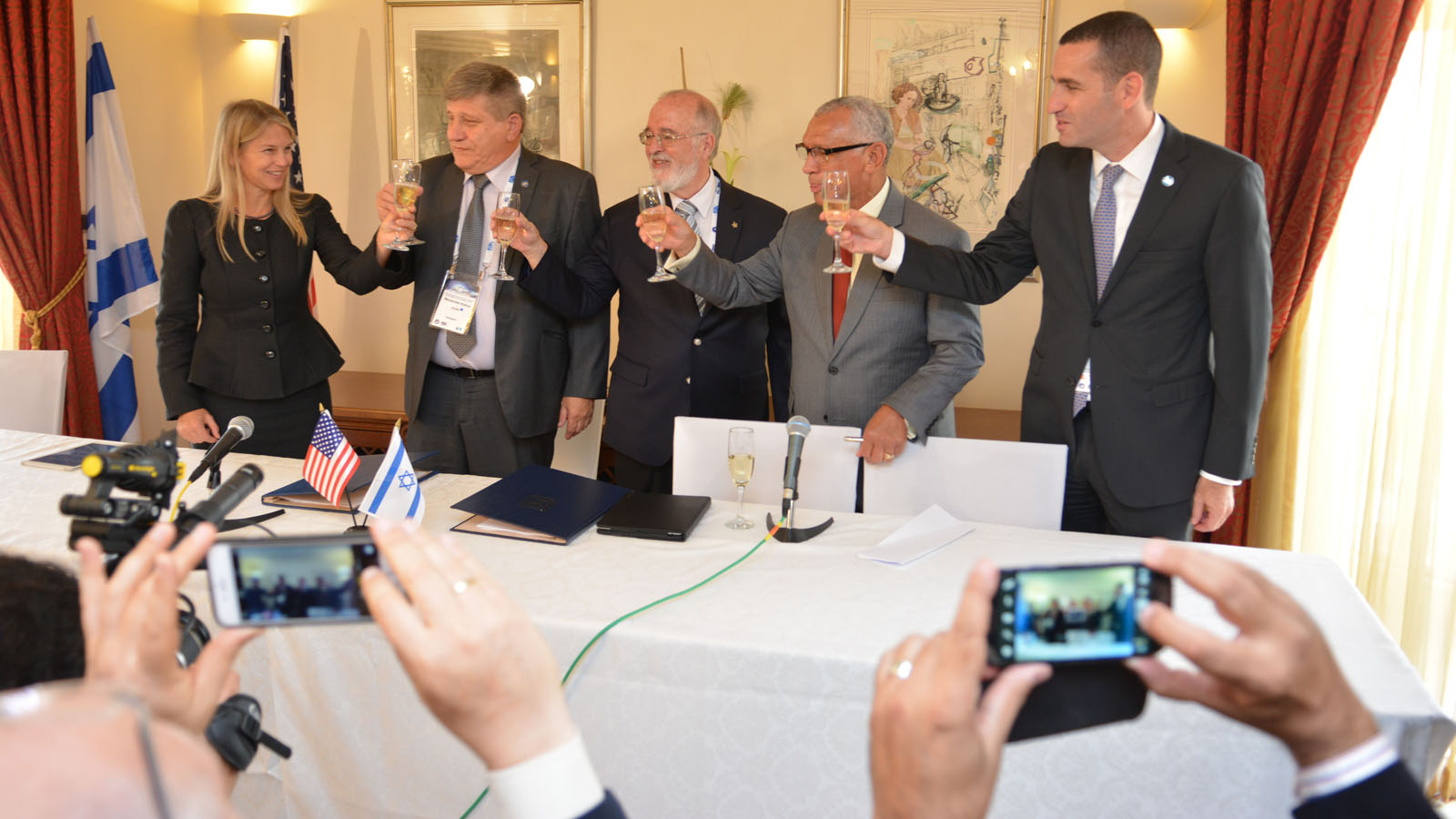 Raising a l'chaim to the new NASA-Israel Space Agency cooperation agreement at the International Astronautical Congress in Jerusalem. Photo by Yair Zrika