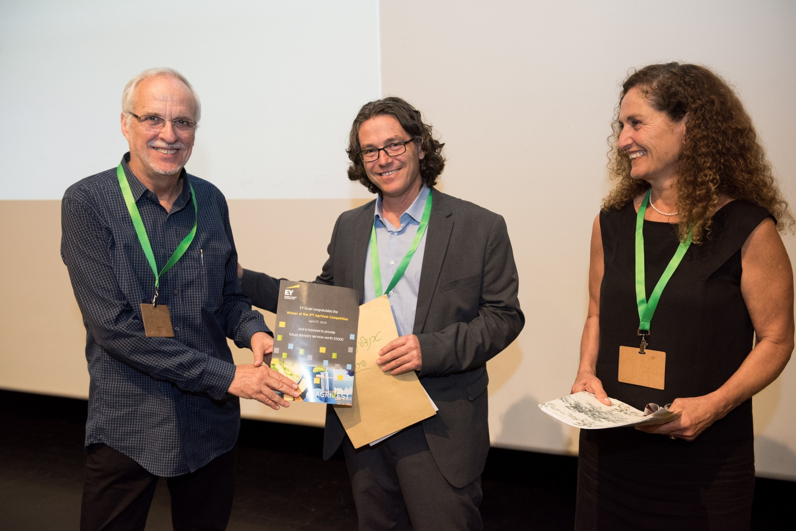 DouxMatok's Eran Baniel, left, receiving the AgriVest 2015 Best Company award from Director of the Investment Promotion Center of the Israeli Ministry of Industry, Trade and Labor Oded Distel and Nitza Kardish, CEO of Trendlines Agtech. Photo by Nitzan ZoharTrendlines Group