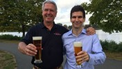 Harpoon President Charlie Storey, left, sharing a brew with Desalitech CEO Nadav Efraty next to Boston's Charles River. Photo: courtesy