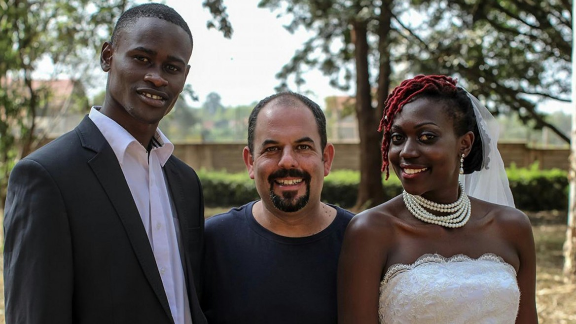 Gilad Millo with theater director Catherine Enane and dancer Tony Toselito Tosedo during the shooting of the music video for his song Sema Milele. Photo via Facebook