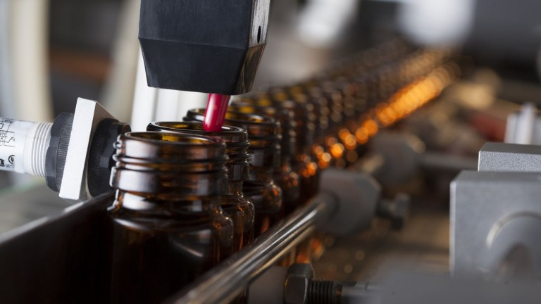 The Induction Integrity Verification System checks every bottle after it's sealed. Image via Shutterstock.com