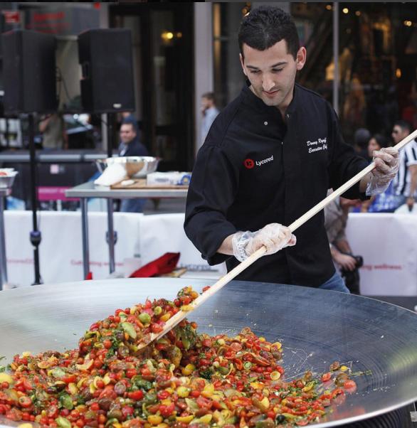 New York Chef Donny Rogoff creates 132-variety tomato salad record. Photo from Fitness Magazine Instagram