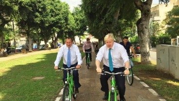 Mayors Johnson, right, and Huldai cycling around Tel Aviv on Tel-O-Fun bikes. Photo via Facebook