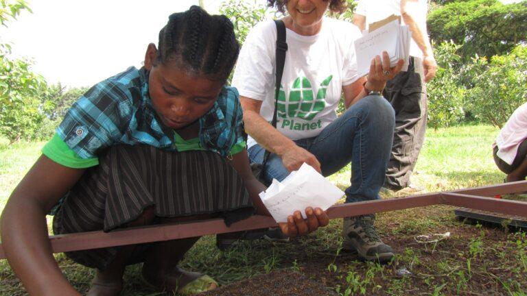 Fair Planet founder Shoshan Haran guiding a young Ethiopian farmer in planting the seeds. Photo courtesy