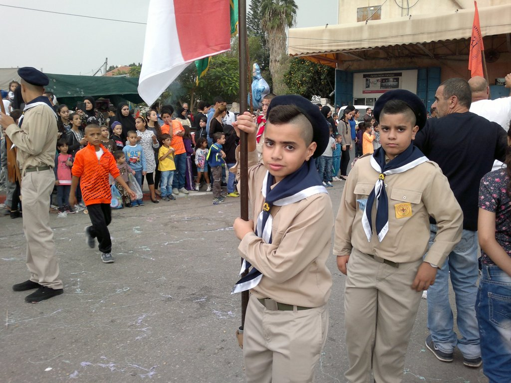 Children marching to church on St. George Day in Lod. Photo by Abigail Klein Leichman