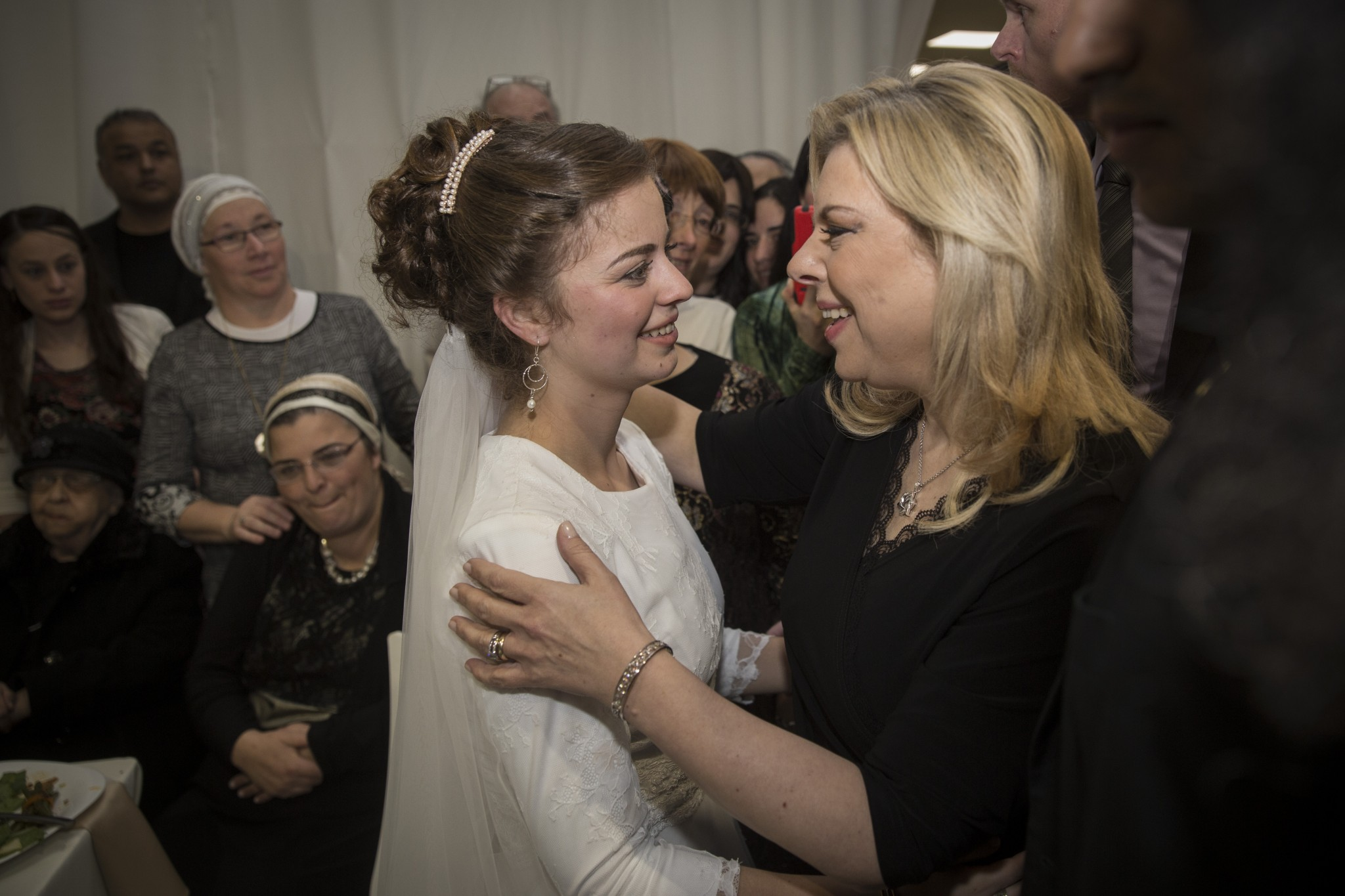 Sara Netanyahu greeting Sarah Litman at her wedding in the Jerusalem International Convention Center. Photo by Hadas Parush/FLASH90