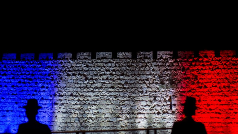 The walls of the Old City in Jerusalem were lit up in red, white and blue in solidarity  with the French. Photo ByYonatan Sindel/Flash90