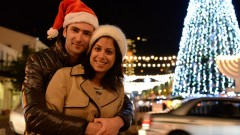 A couple gets into the Christmas spirit in the German Colony district of the northern Israeli city of Haifa. Photo by Sapir BronzbergFLASH90
