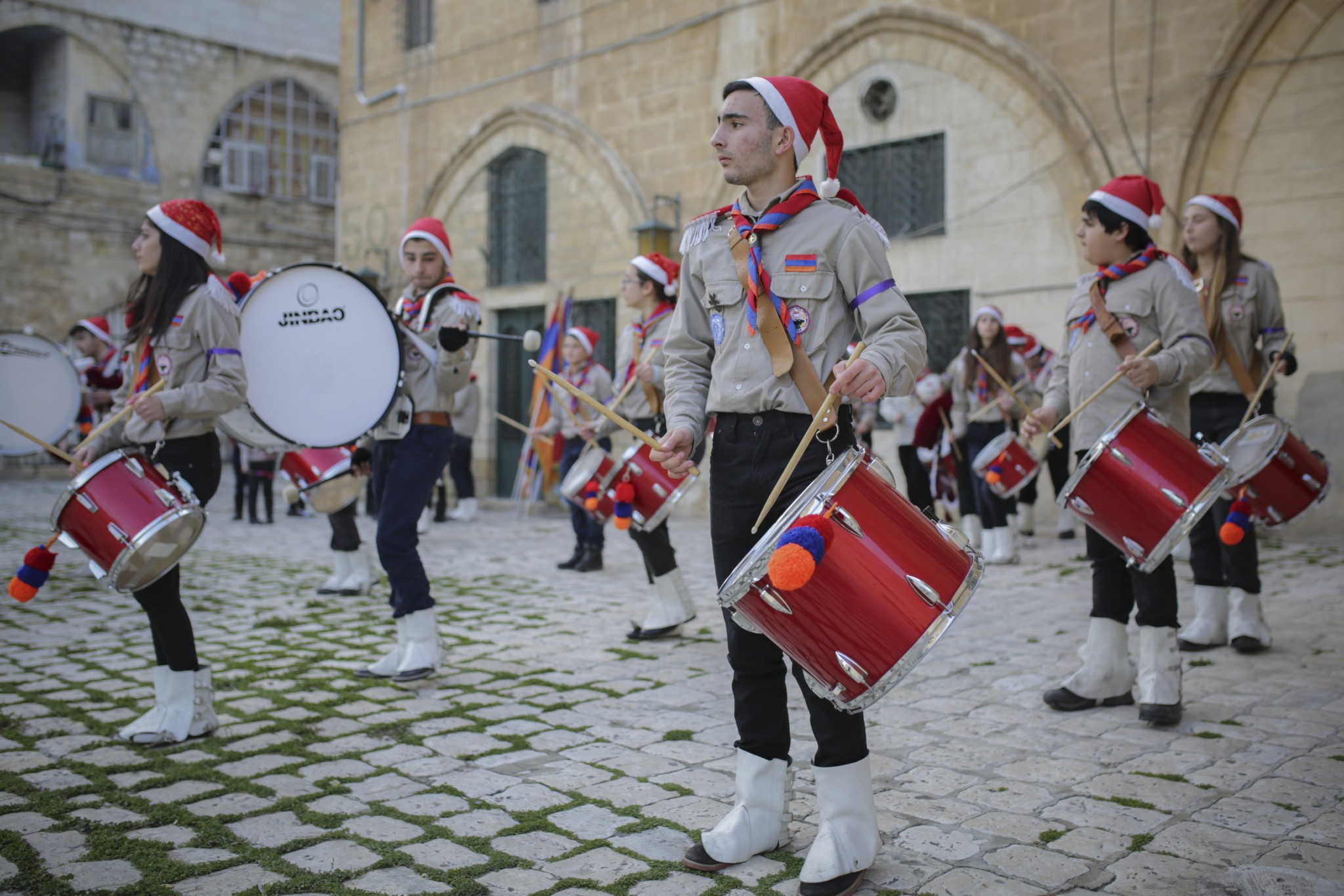 Christians march during an Armenian Christmas procession through the Old City of Jerusalem. Photo by Maxim DinshteinFLASH90