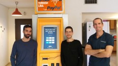 TravelersBox founders, from left, Dror Bluementhal, Idan Deshe and Tomer Zussman at one of its kiosks in Istanbul. Photo courtesy of TravelersBox