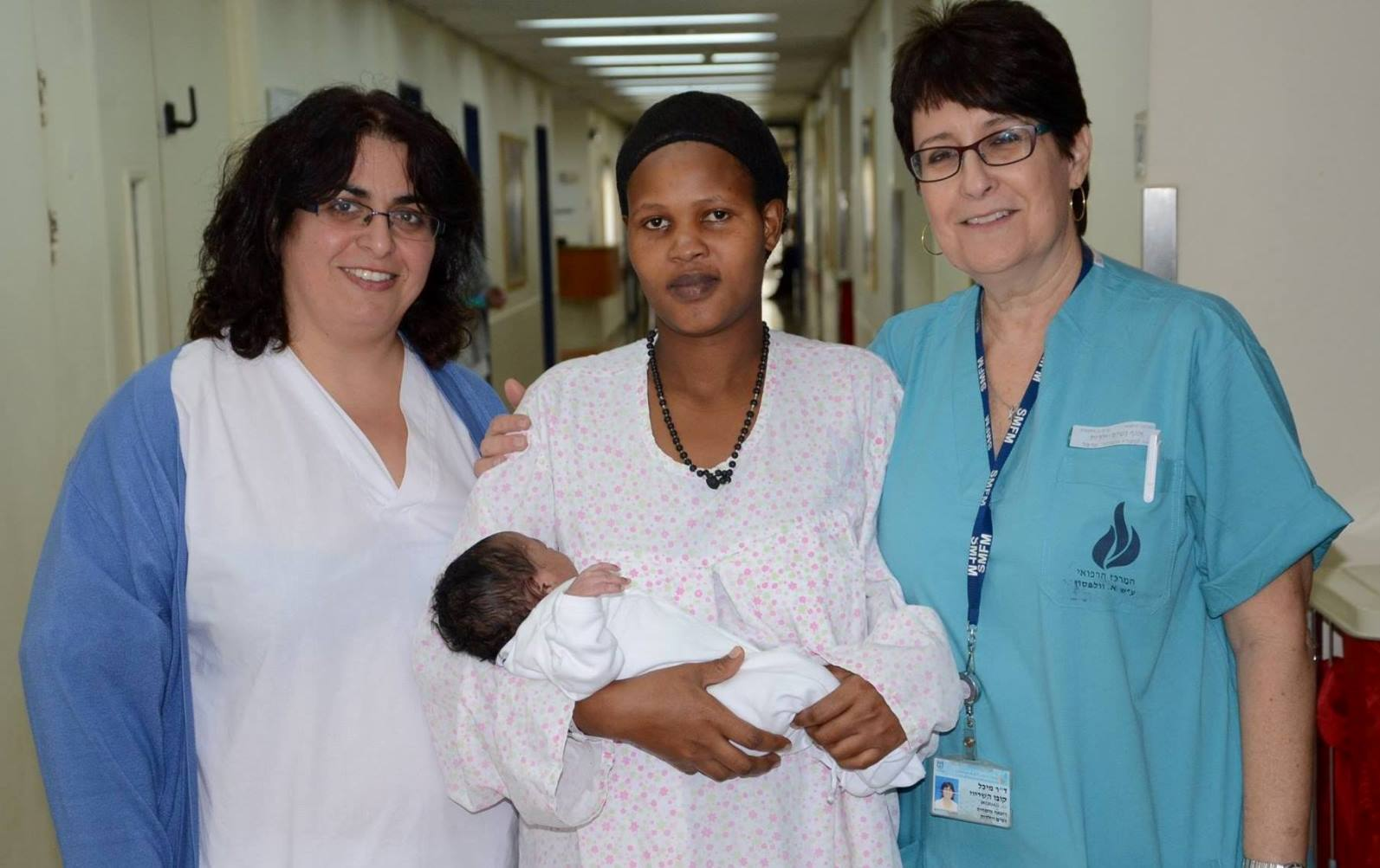 Elieth and baby Laura, flanked by nurse Limor Cooper-Sasson and Dr. Michal Kobo in the maternity department at Wolfson. Photo by Batak Nuna