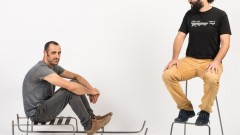 Neil Nenner, left, and Lior Yamin of SAGA TLV gallery in Jaffa trying out Nenner's minimalist seating designs. Photo by Shachar Fleischmann