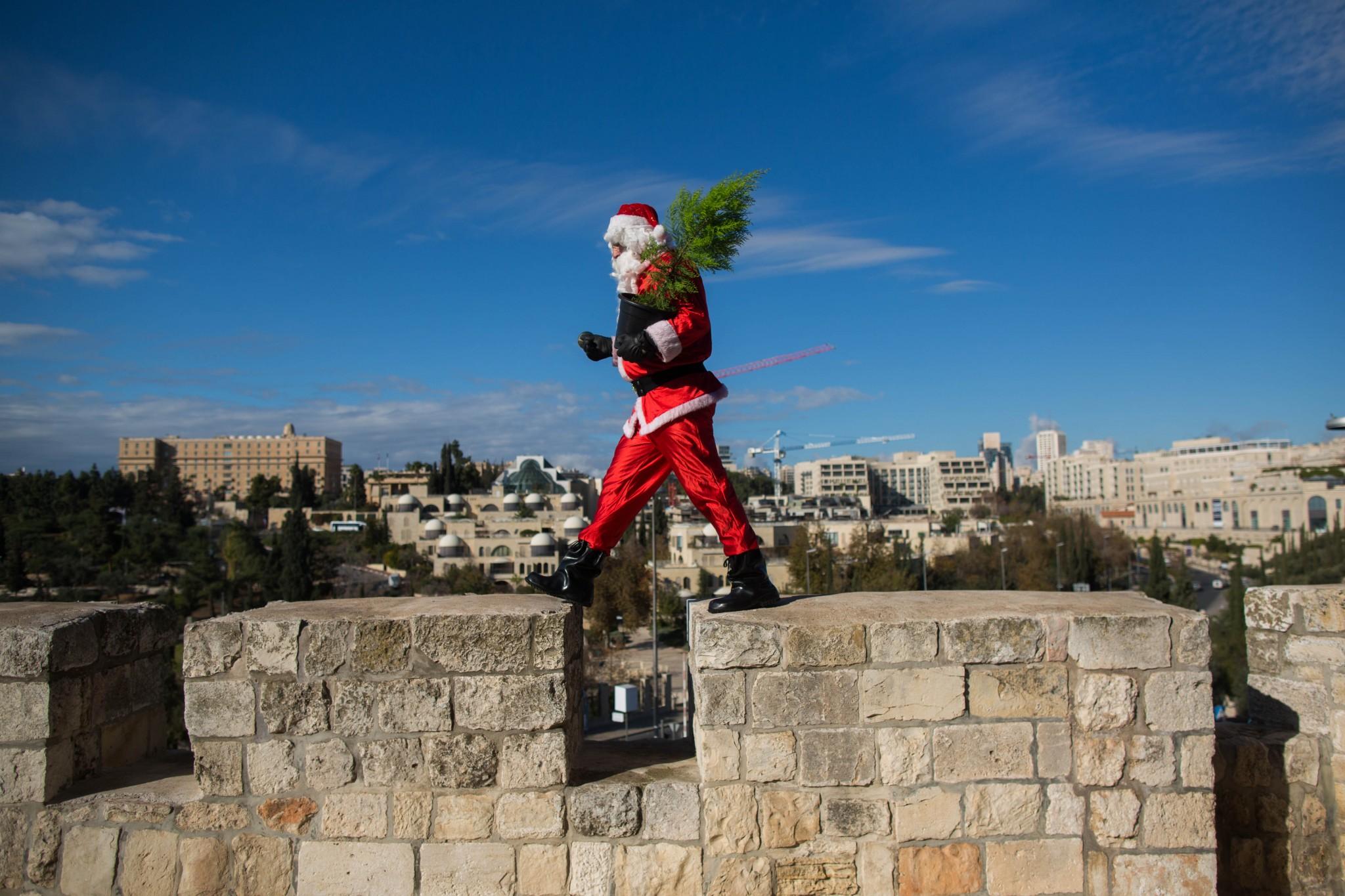 Santa walks the walls of Jerusalem's Old City last December. Photo by Yonatan SindelFLASH90