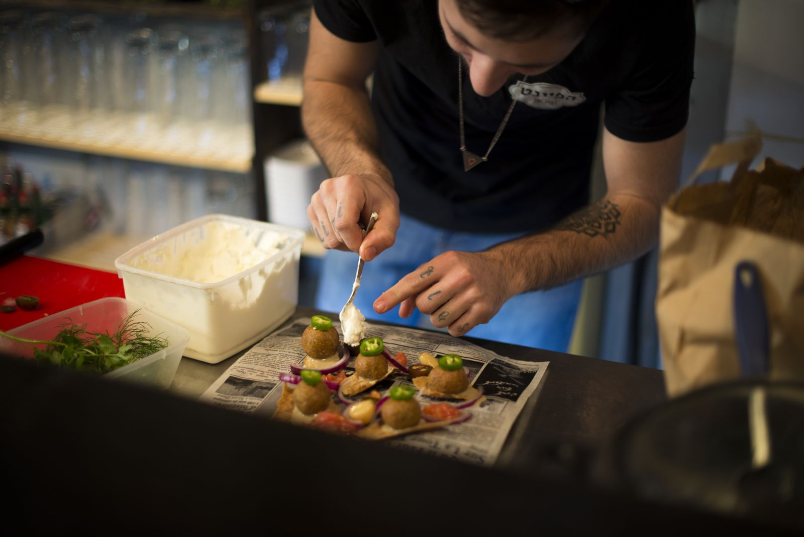 A time-consuming delicacy being prepared in the kitchen of Haifa's Pint Pub. Photo: courtesy