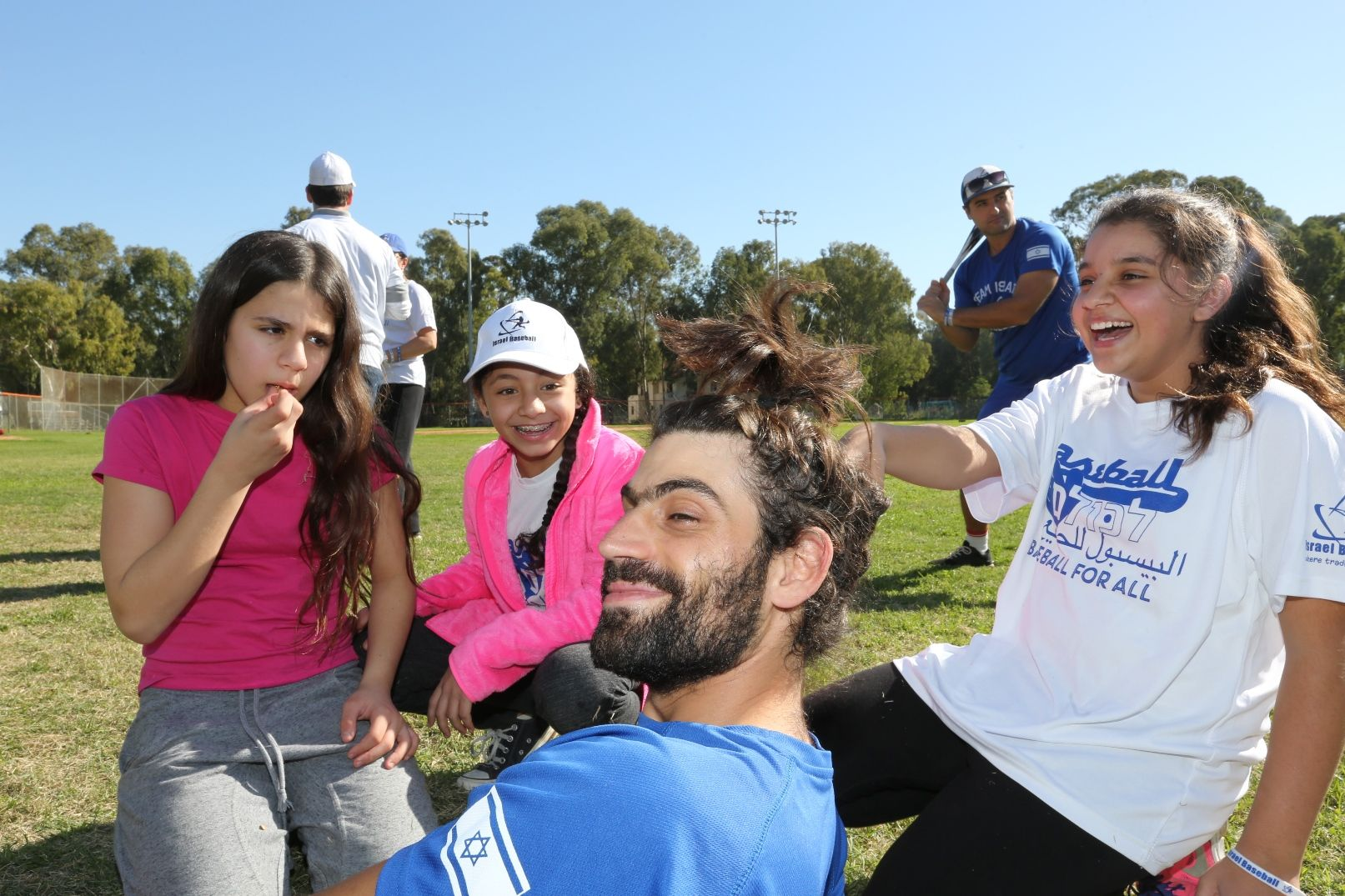 Participants from Ramla kidding around with head coach Ophir Katz. Baseball for All director Nate Fish is in background at right. Photo: Yossi Zamir/JNF