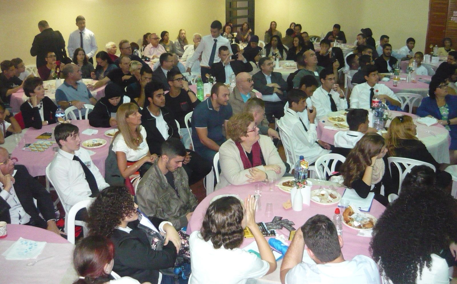 "Visitors listening to a panel of Lod ""champions"" at a luncheon in the Chicago Jewish-Arab Community Center. Photo by Ester Ochigava Moshe"