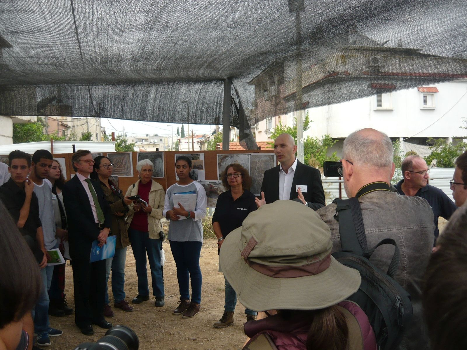 Archaeologist Hagit Torgë and Deputy Mayor Aviv Wasserman speaking with reporters at the unveiling of the newest Lod mosaic. Photo by Ester Ochigava Moshe