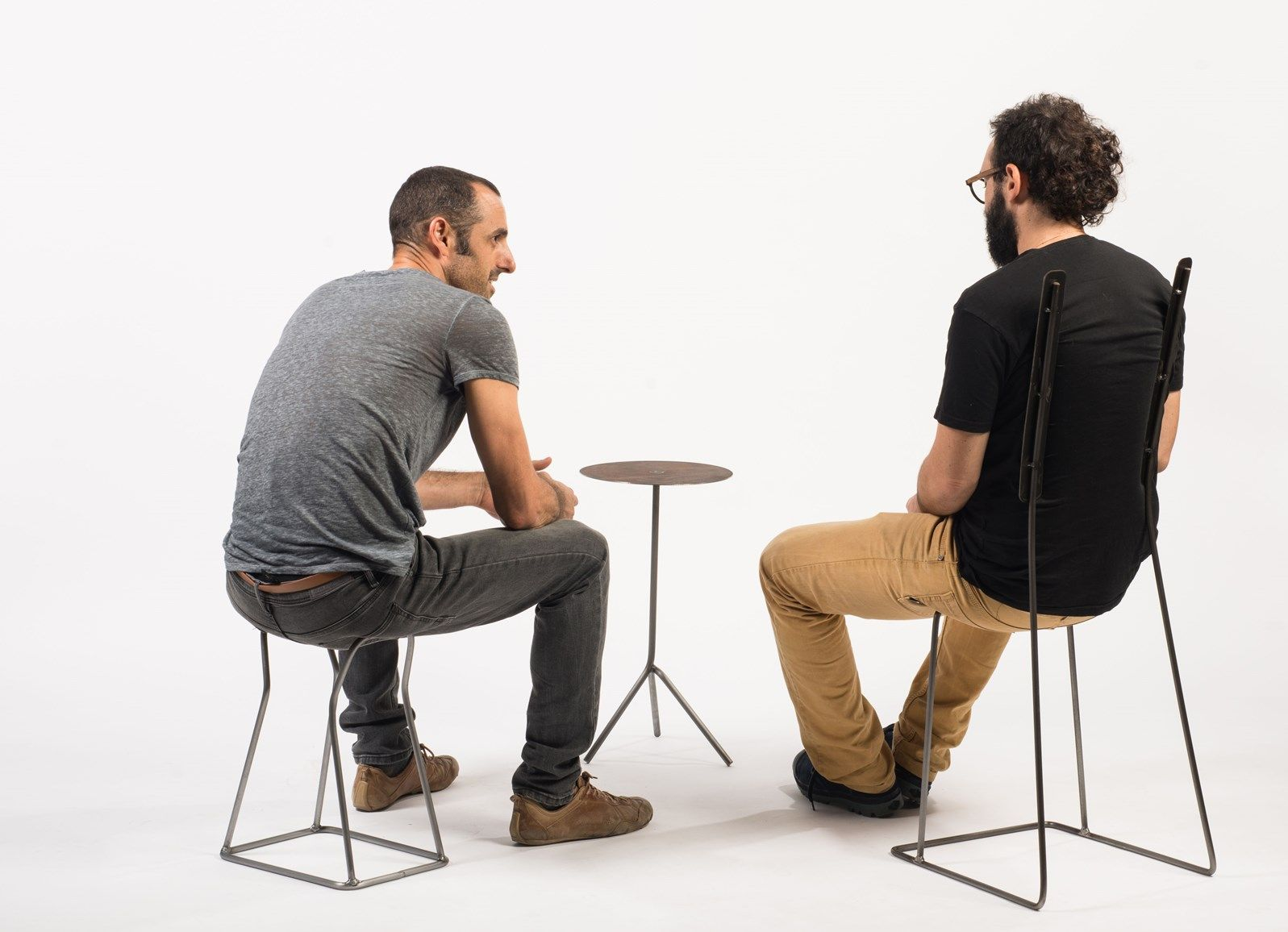Neil Nenner and Lior Yamin sitting on the One-Line Stool and Two-Notes Chair. Photo by Shachar Fleischmann