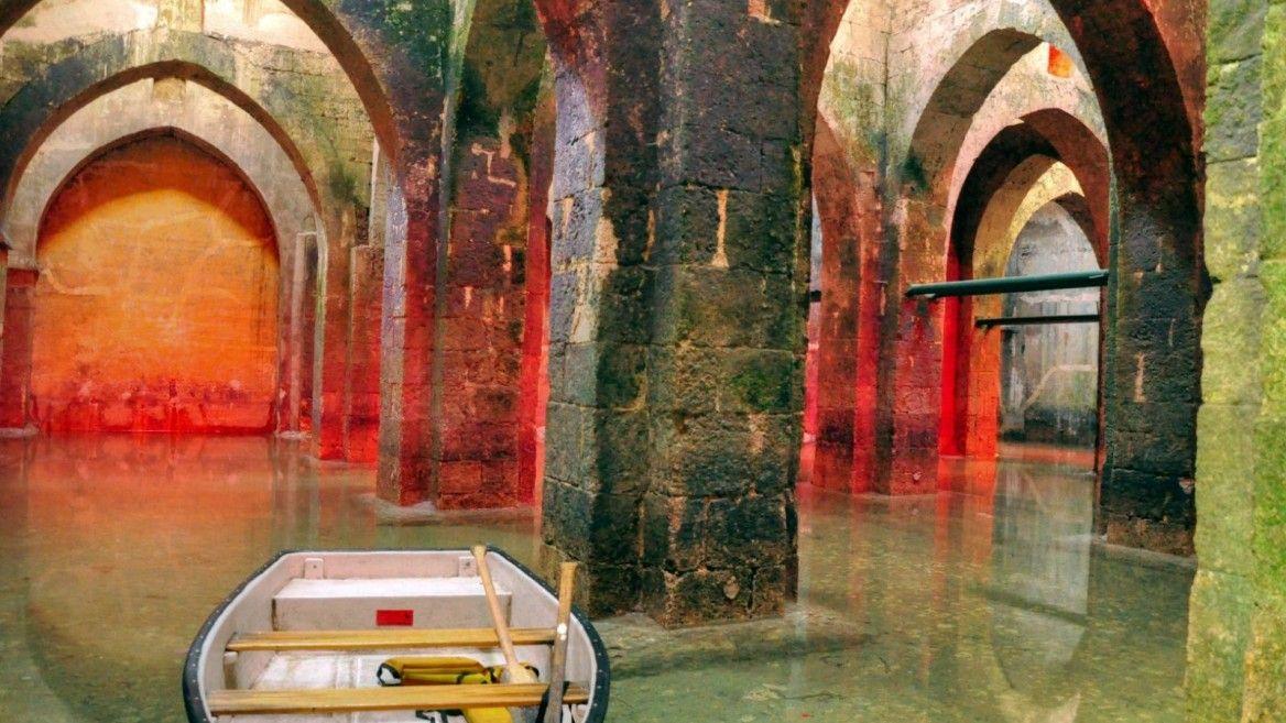 Boating through the underground reservoir in Ramla. Photo via BibleWalks.com