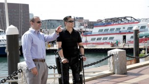 Robert Woo, paralyzed in a freak construction accident, shows off the ReWalker 6.0 version of the Israeli-made exoskeleton system that has given him a second chance to walk again. Photo by ReWalk