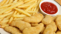 Could convenience foods like fries, ketchup and chicken nuggets cause autoimmune diseases? Image via Shutterstock.com