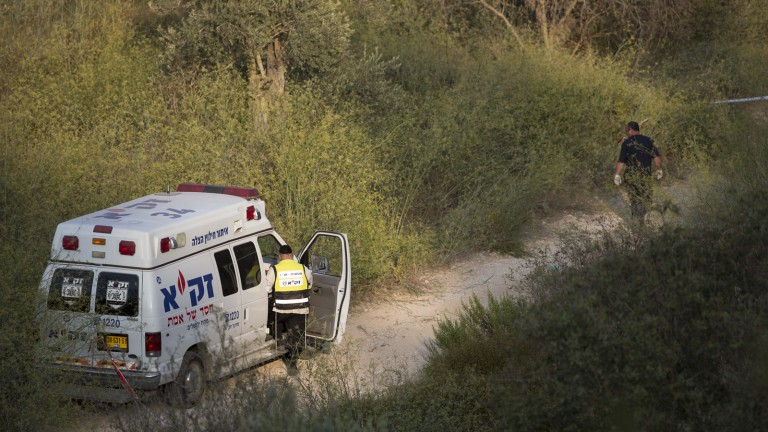 Policemen and volunteers of the ZAKA rescue and recovery organization seen near the Jerusalem Forest in 2014. Photo by Yonatan Sindel/Flash90