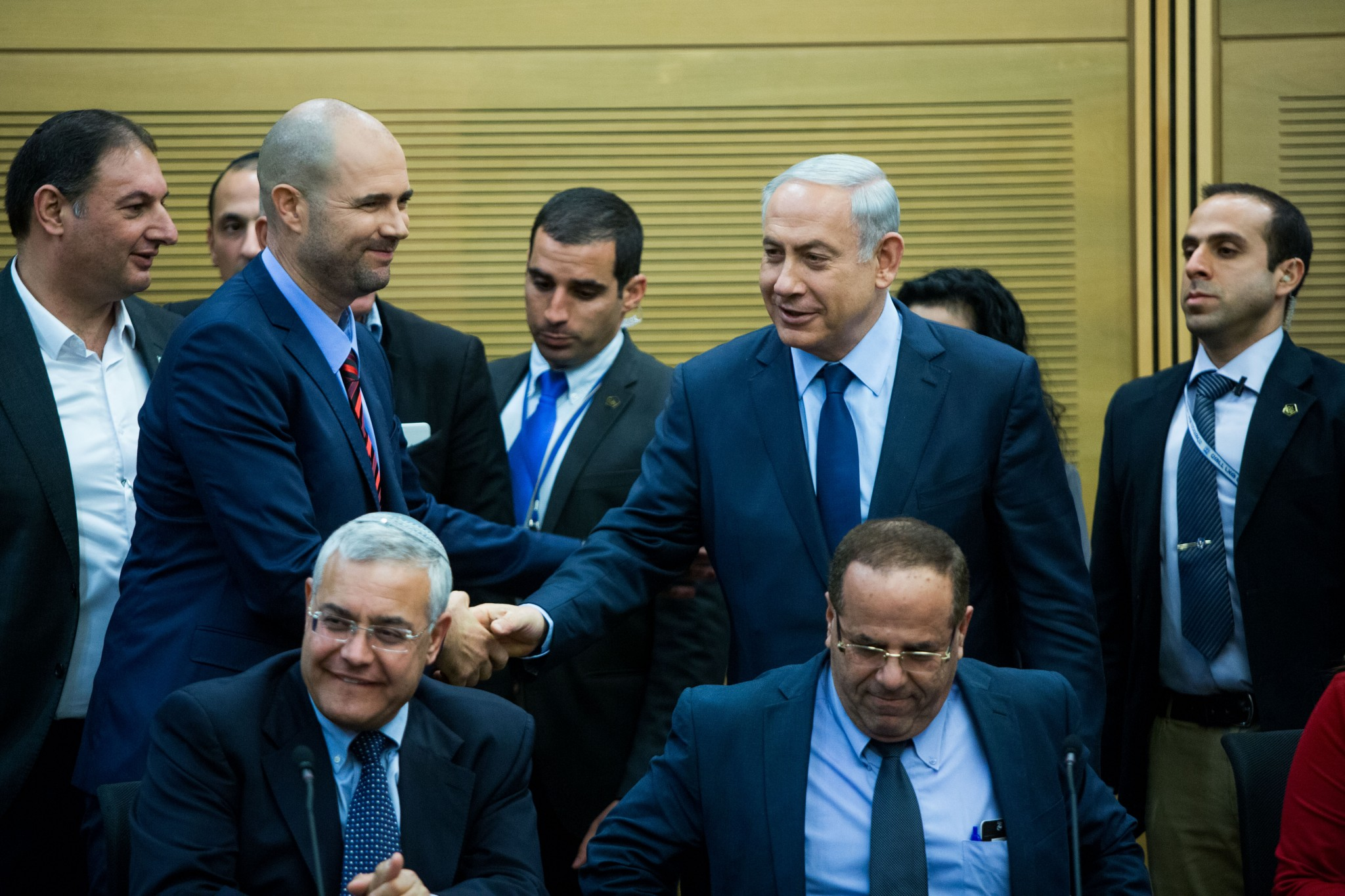 Prime Minister Benjamin Netanyahu shakes hands with new Likud MK Amir Ohana during a party faction meeting at the Knesset. Photo by Yonatan Sindel/Flash90