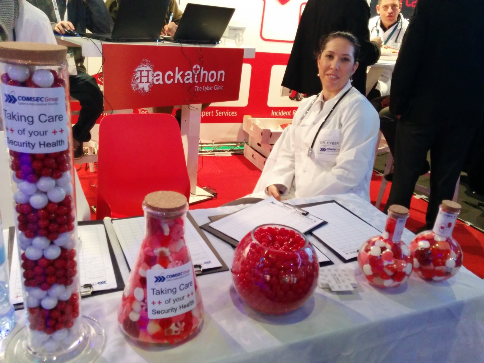 """The COMSEC Group's booth offered """"medicine"""" from """"Dr. Cyber."""" Photo by Viva Sarah Press"""