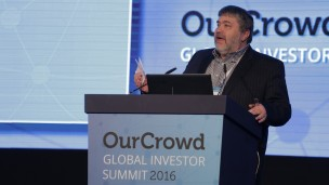 Jon Medved speaks to the audience at the 2016 OurCrowd Global Investor Summit in Jerusalem. Photo courtesy