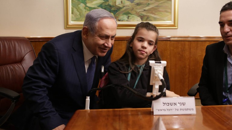 Shani Eshkol, 13, shows Israeli Prime Minister Benjamin Netanyahu how to operate her Sesame Phone using only head movements. Photo by Eyal Gaziel