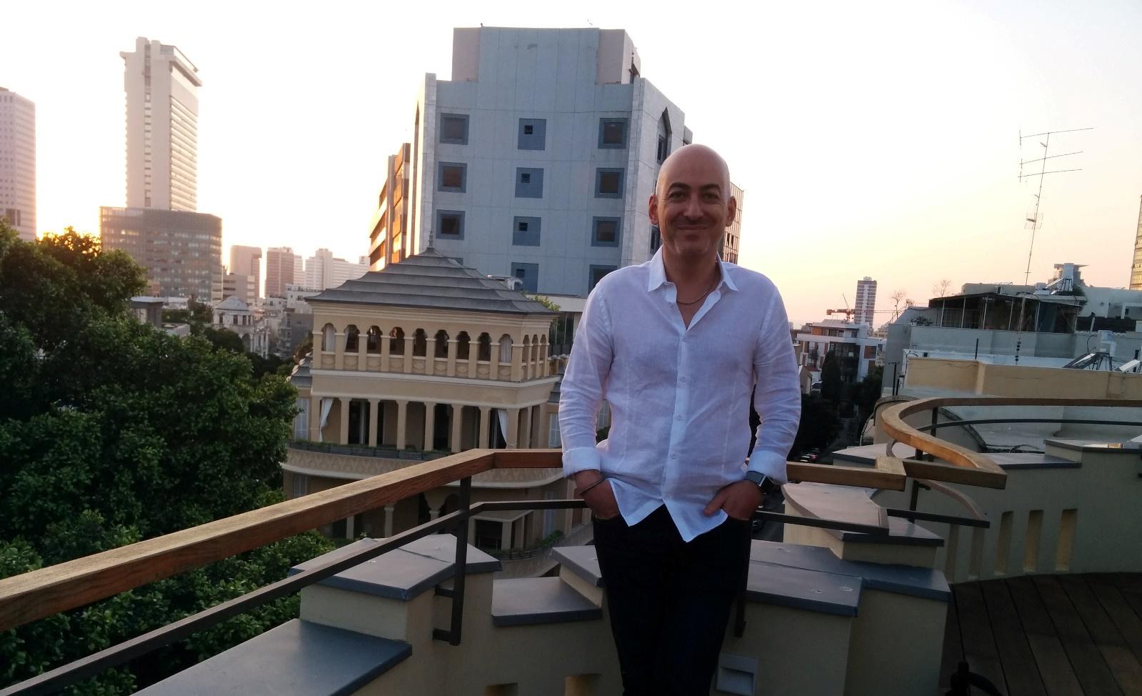 Shlomo Benartzi on the roof of The Norman Hotel in Tel Aviv. Photo by Abigail Klein Leichman
