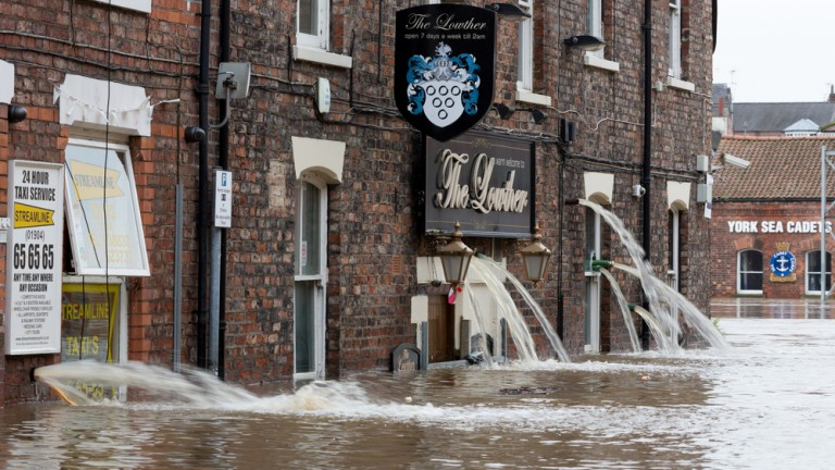 Flooded streets of King's Staith in York City Center after heavy rain in December 2015. Photo by Shutterstock.com