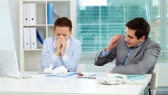 Feeling sick at work? Take a hint from your body and go home. Image via Shutterstock.com
