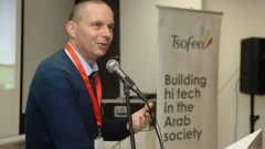 Entrepreneur Izhar Shay speaking at the TRI/O Tech hub opening. Photo from Facebook