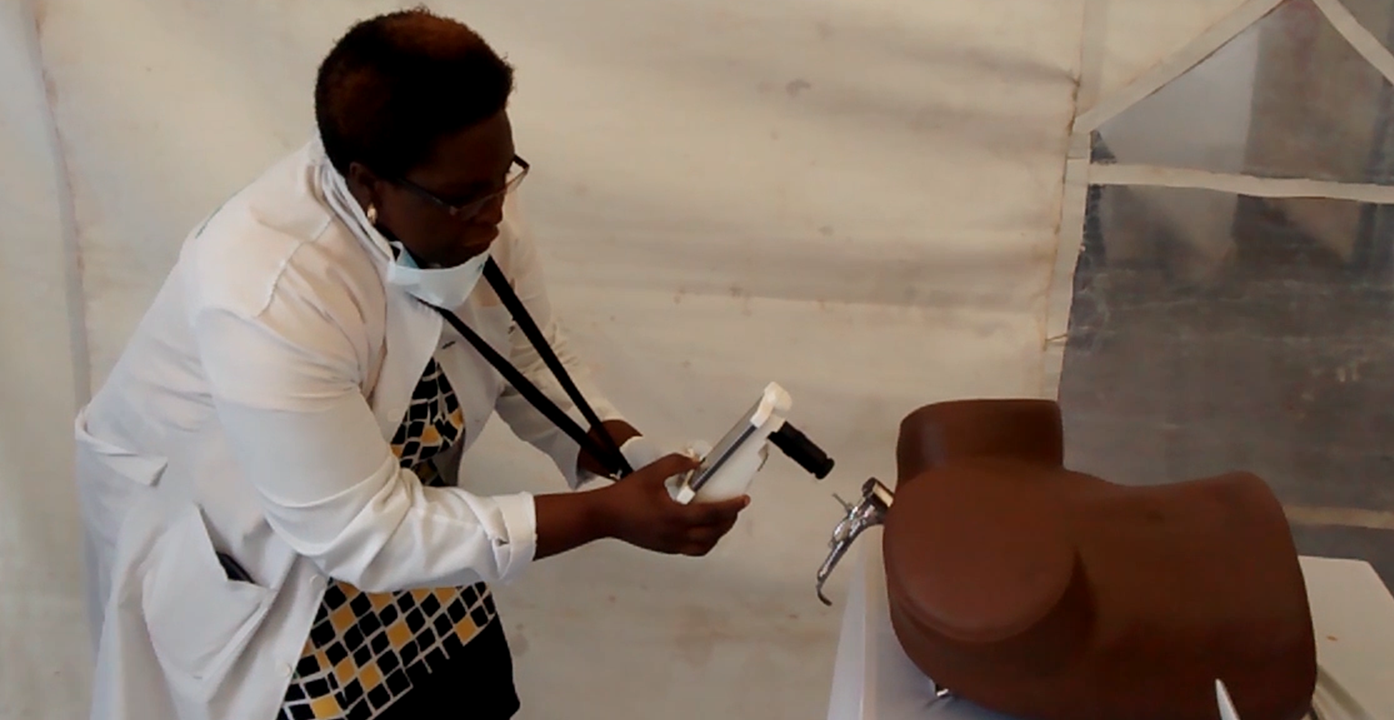 A local nurse learning to use MobileODT before last year's screening camp in Kenya. Photo courtesy of MobileODT