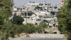 A residential area destroyed by bombing in Syria. Photo by Volodymyr Borodin, www.shutterstock.com