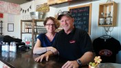 Pam and Denny Neilson at Buster's Beverage Company in Beit Shemesh. Photo by Abigail Klein Leichman
