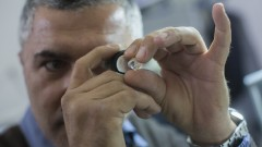 A man examines a diamond during the International Diamond Week at the Israel Diamond Exchange center in Ramat Gan. Photo by Yonatan Sindel/Flash90