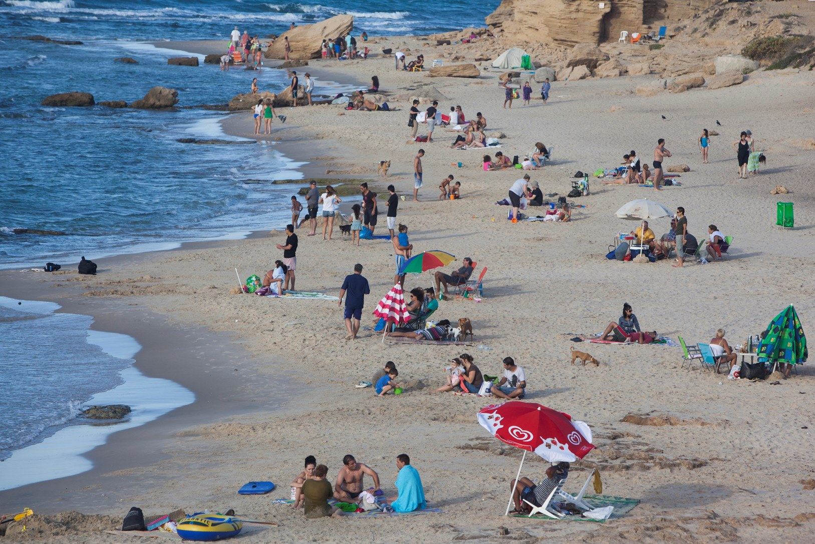 Sunbathers at Palmahim Beach near Rishon LeZion. Photo by Yonatan Sindel/FLASH90