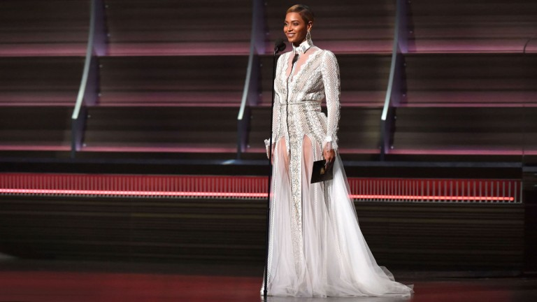 Beyoncé sparkles in an Inbal Dror wedding dress at the Grammy Awards. Photo by Getty