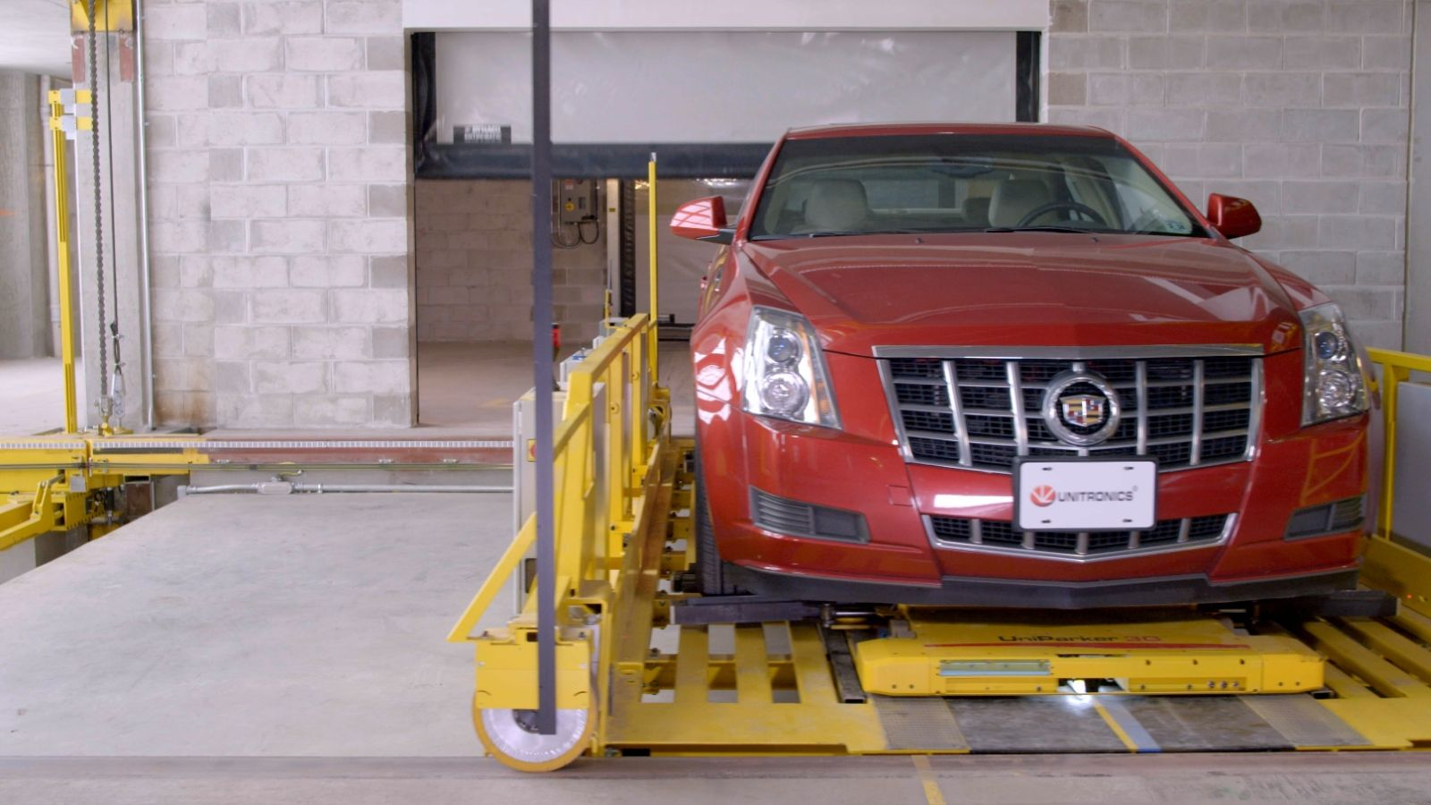 The robots use automated elevators to bring cars to available spots. Photo: courtesy