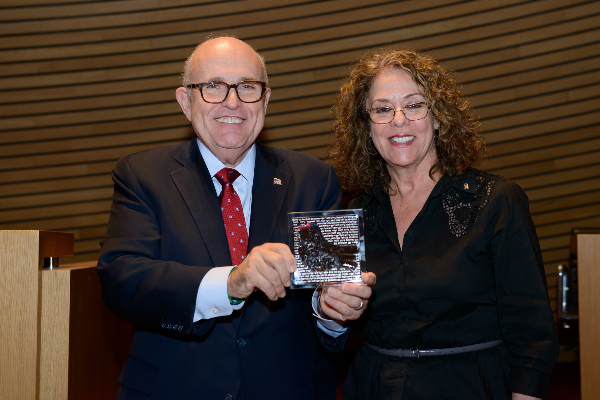Former New York City Mayor Rudolph Giuliani holds a dove of peace plaque given to him by BGU President Prof. Rivka Carmi. Photo by Dani Machlis/BGU