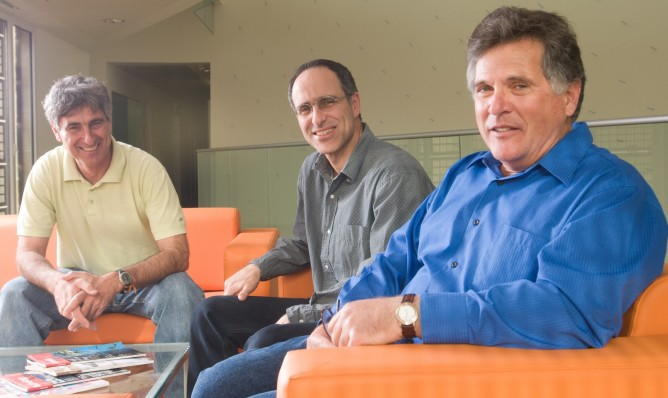 Prof. Eilon Adar, right, with colleagues at Ben-Gurion University. Photo by Dani Machlis/BGU