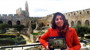 Tower of David Museum Director of New Media Eynat Sharon with the AugmentiGuide from Enviewz. Photo: courtesy