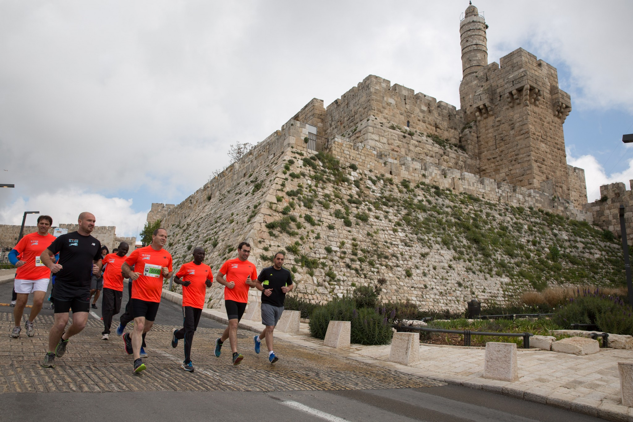 Running the streets of Jerusalem during the city's annual marathon. Photo via Flash 90
