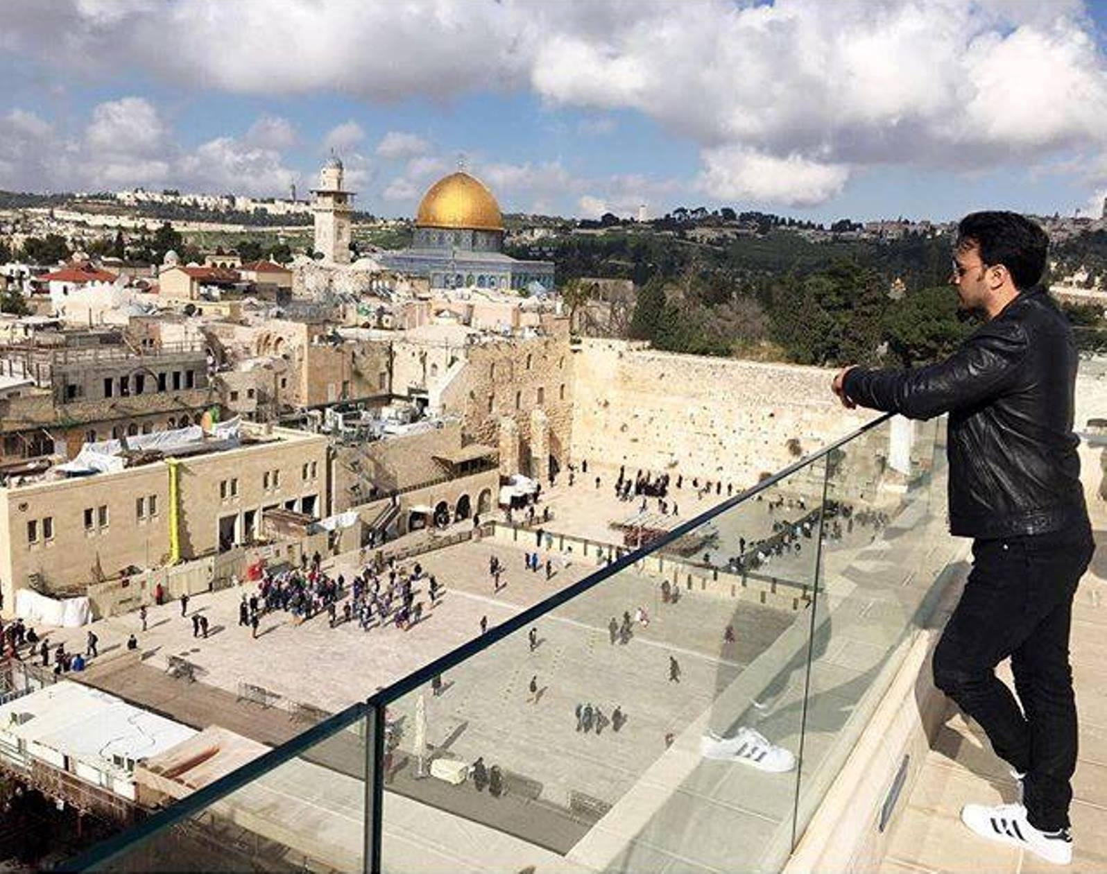 Luis Fonsi looking out at the Western Wall and Temple Mount in Jerusalem. Photo via Facebook
