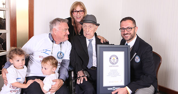 Israel Kristal poses with Guinness World Records' Head of Records Marco Frigatti, Kristal's son Haim Kristal, daughter Shula Kuperstoch and great grandchildren. Photo by Guinness World Records