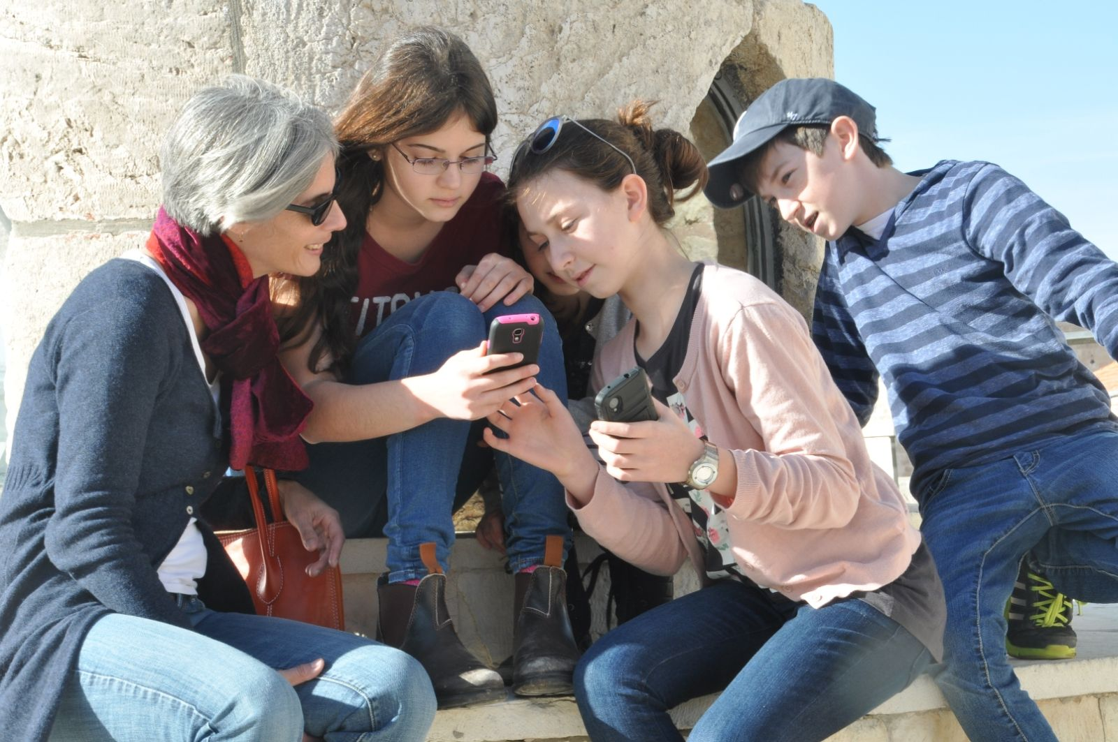 Visitors to the Tower of David Museum using the Quesity app. Photo by Naftali Halberstadt