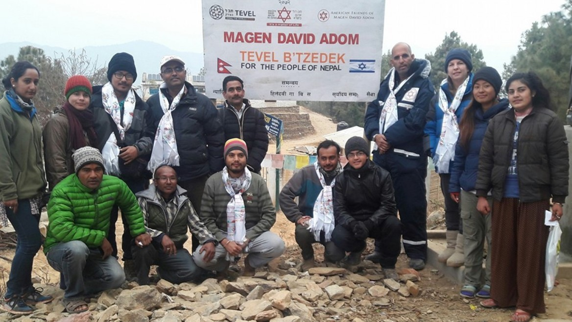 Tevel b'Tzedek and Magen David Adom provided building materials and food to earthquake victims in Nepal. Photo via Facebook