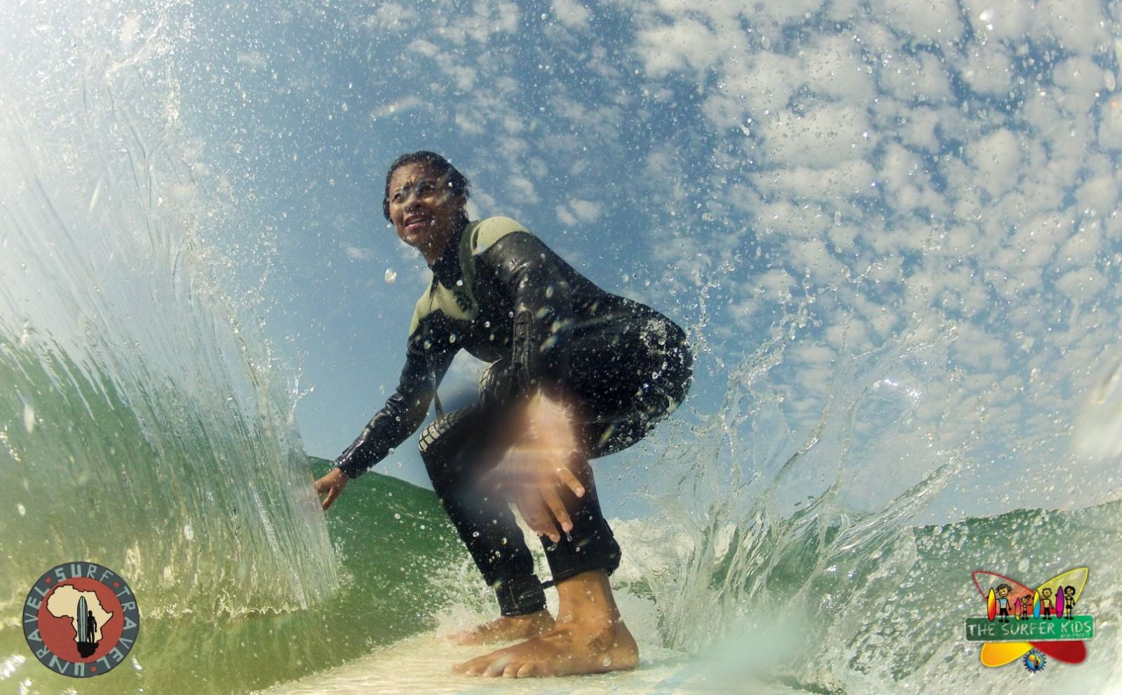 The Surfer Kids- South Africa: A Surfer Kid from Friemersheim, a rural community in South Africa. Travelers can surf with the nonprofit, The Surfer Kids and tour proceeds go toward supporting underprivileged children.
